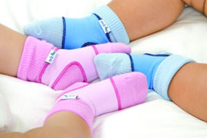 Keep baby socks on with sockons