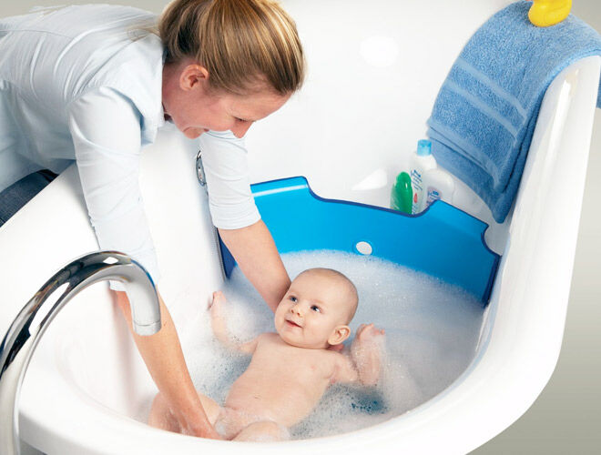 The Baby Dam bathwater barrier turns your family-sized bath into a baby bath
