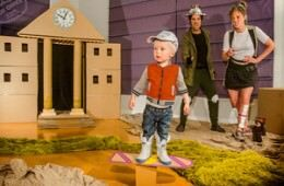 Family use cardboard boxed to recreate famous scenes