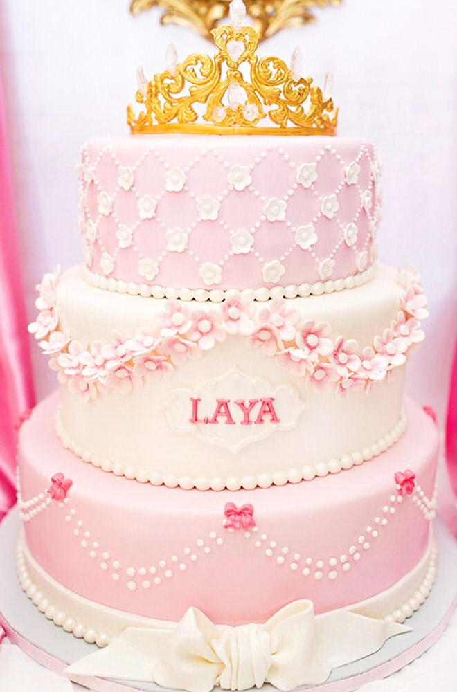 There's a lot to get excited about on this jewel of a cake - The gold crown, the crystal embellishments, the dainty pearls, the sugar flowers. So much pretty!