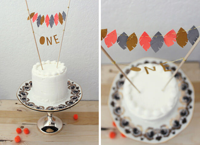 First birthday cake with adorable feather cake topper