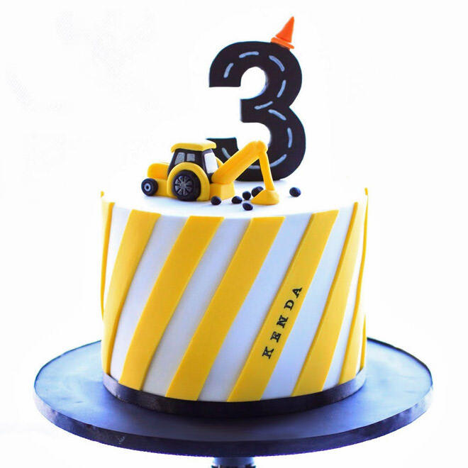 Yellow digger birthday cake
