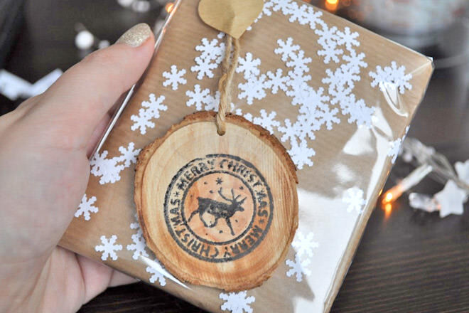 Wrap your present in brown paper and then add your crisp paper snowflakes between the brown paper and a layer of celophane. Easy peasy