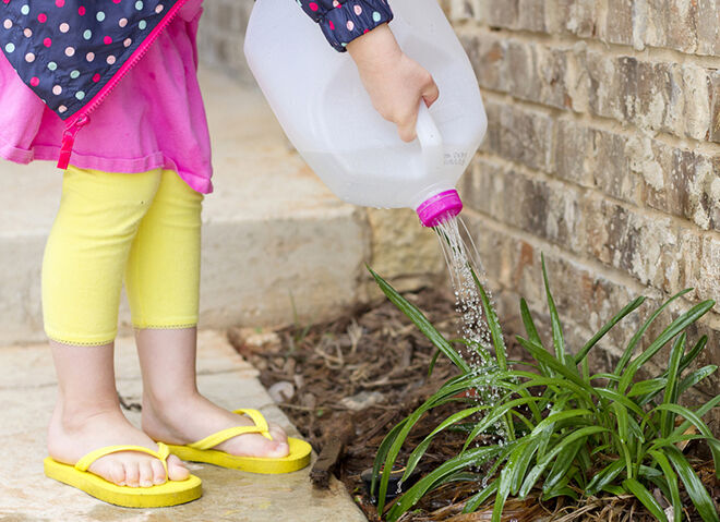 Recycling milk containers are a good Earth Day activities for kids.