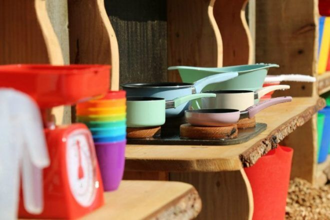 outdoor mud kitchen pots and colourful accessories