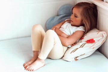 sick girl with tummy ache