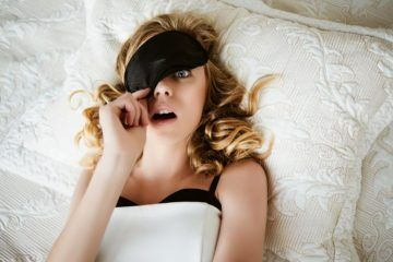 surprised woman wearing eye mask pregnancy dreams