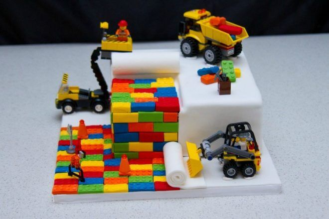 Lego cake with bricks and construction figurines