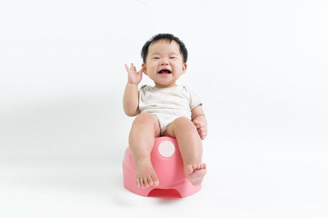 starting toilet training: Little boy sitting on the potty