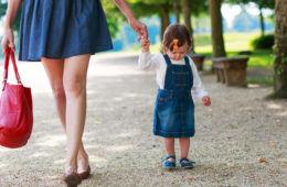 mum walking outdoors with toddler