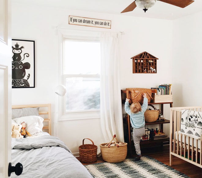Boho style baby and toddler shared room