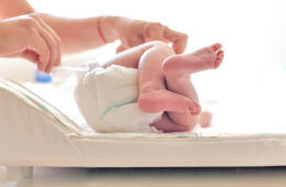 Newborn having nappy changed