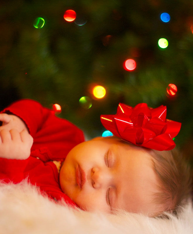 Baby's first Christmas photo with a bow in her hair