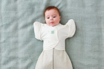 ergoPouch Butterfly Cardi helps baby transition from swaddle to sleeping bag in three easy steps