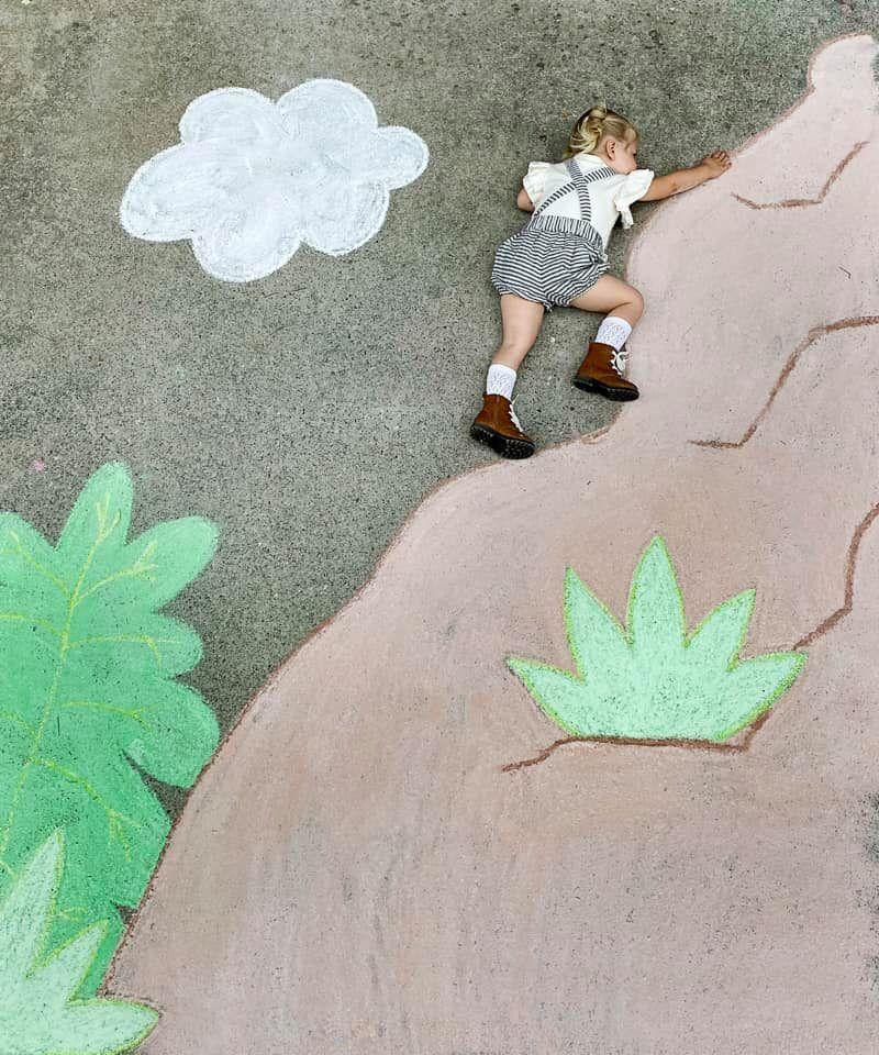Abbey Burns Tucker side walk chalk art mountian climber