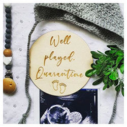 Wooden sign pregnancy announcement