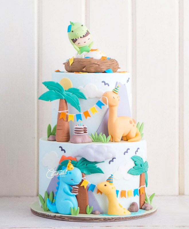 Colourful tiered 3D dinosaur cake