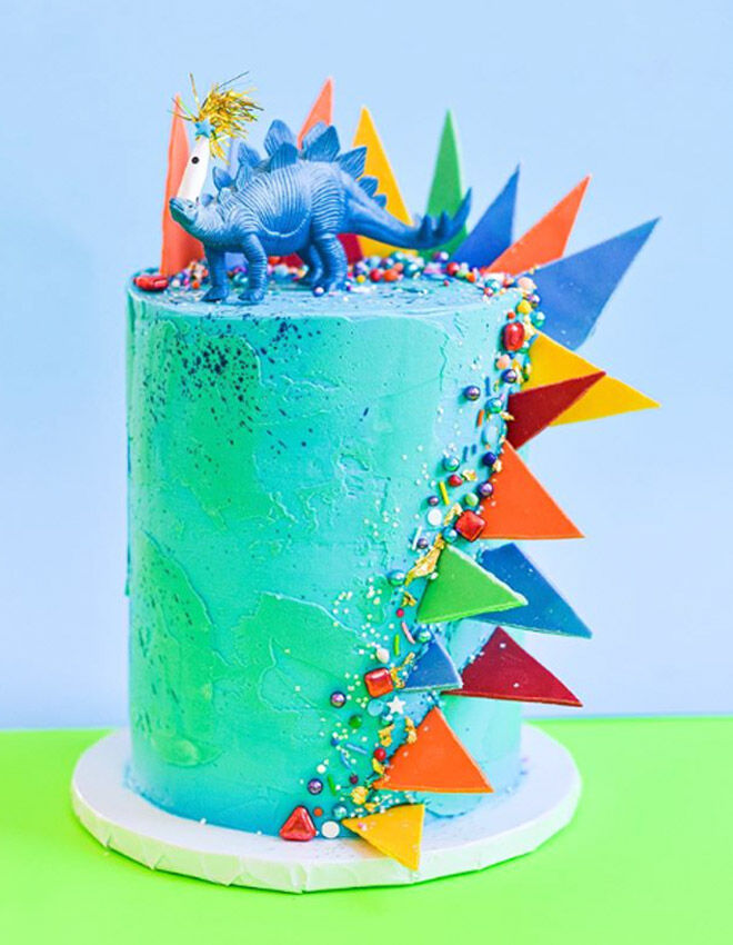 dinosaur cake with colourful spikes